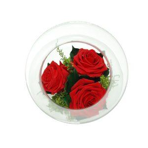 Il Centrotavola in vetro con rose stabilizzate rosse Parodia